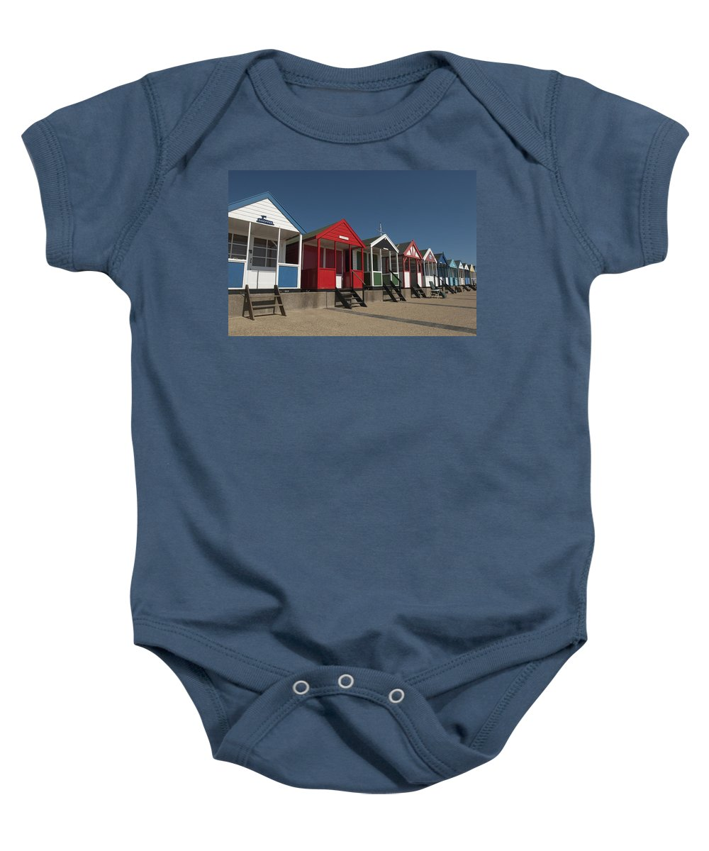 Suffolk Baby Onesie featuring the photograph Traditional Beach Huts On The Seafront by Axiom Photographic