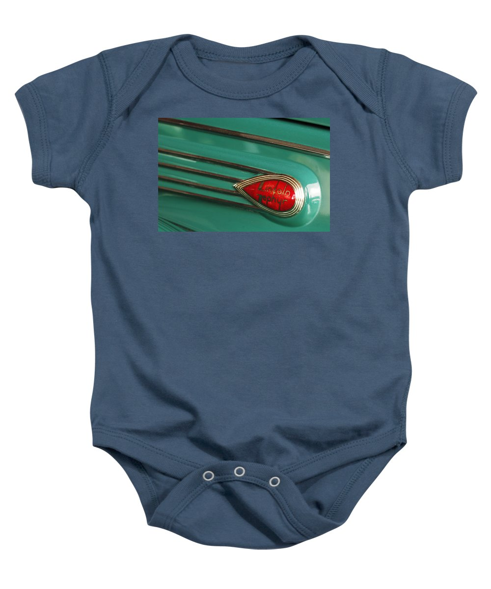 Car Baby Onesie featuring the photograph 1938 Lincoln Zephyr Convertible Sedan Emblem by Jill Reger