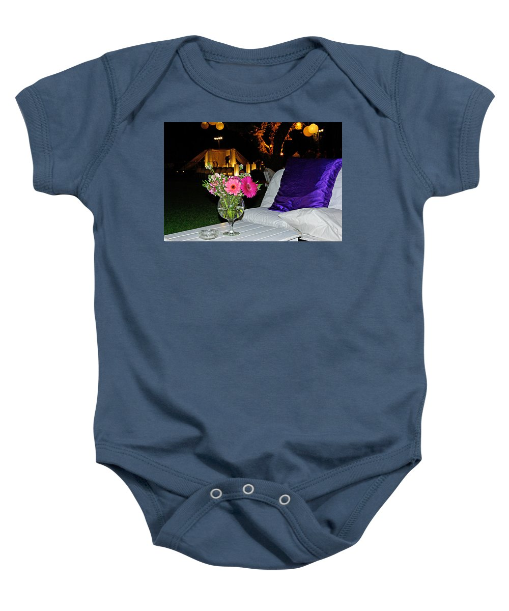Flowers Baby Onesie featuring the photograph Flowers In A Vase On A White Table by Zal Latzkovich