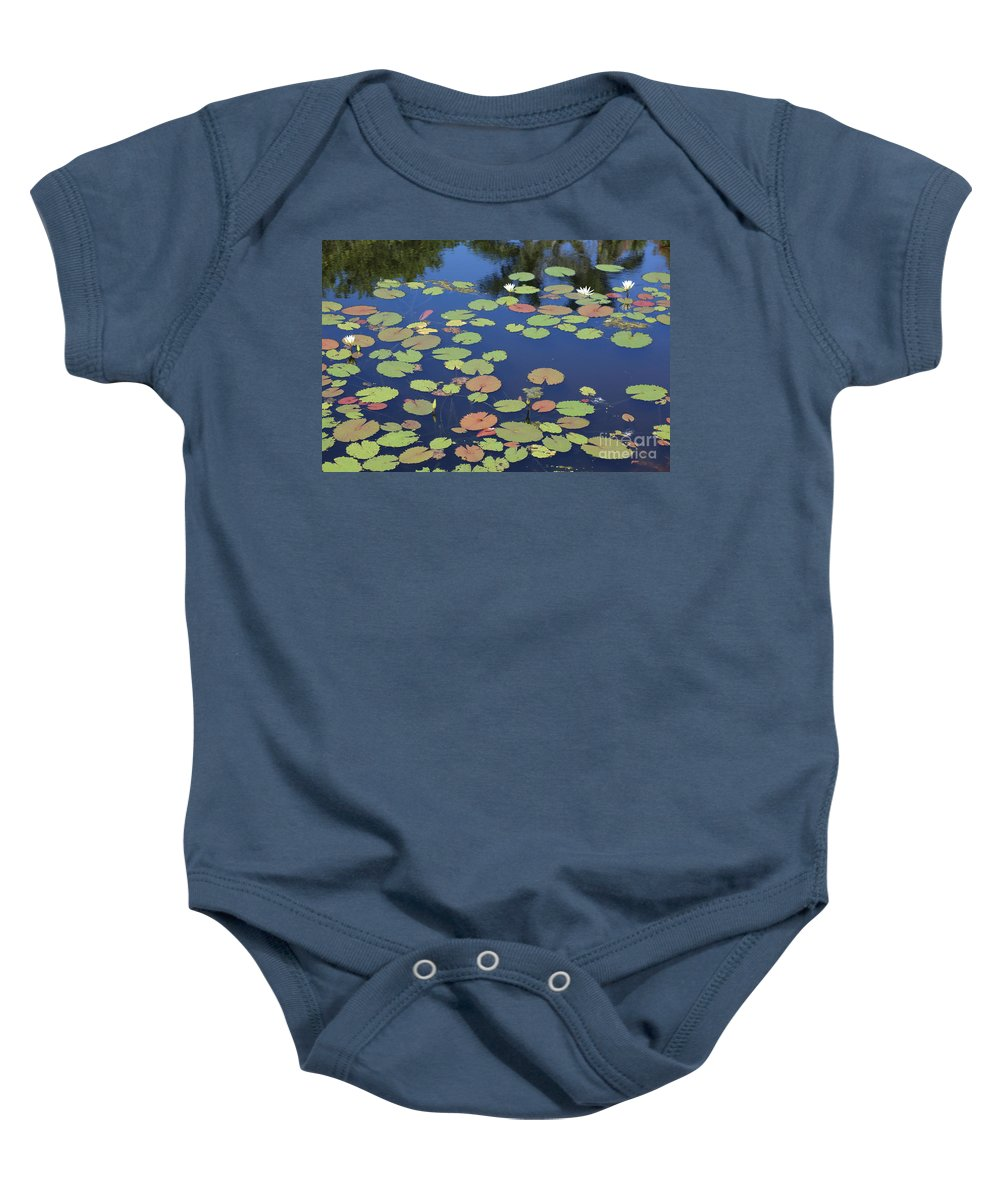 Pond Baby Onesie featuring the photograph Lily Pads On Blue Pond by Carol Groenen