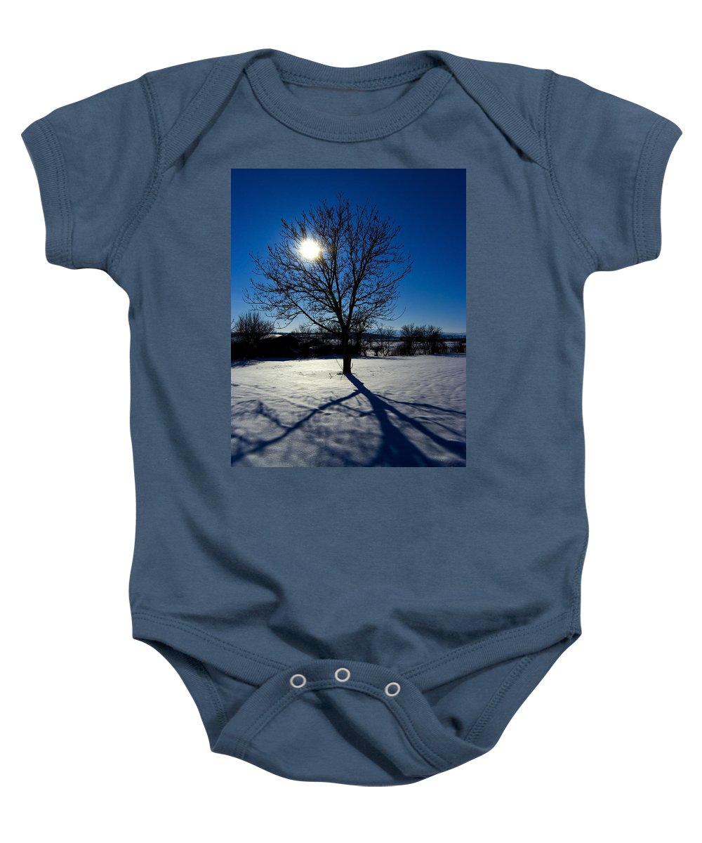 Tree Baby Onesie featuring the photograph Tree Into Sun On A Winter Snowy Afternoon by Cliff Norton