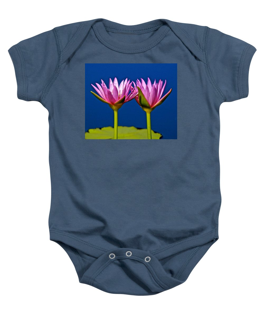 Lotus Baby Onesie featuring the photograph Water Lilies Touching by Joe Wyman