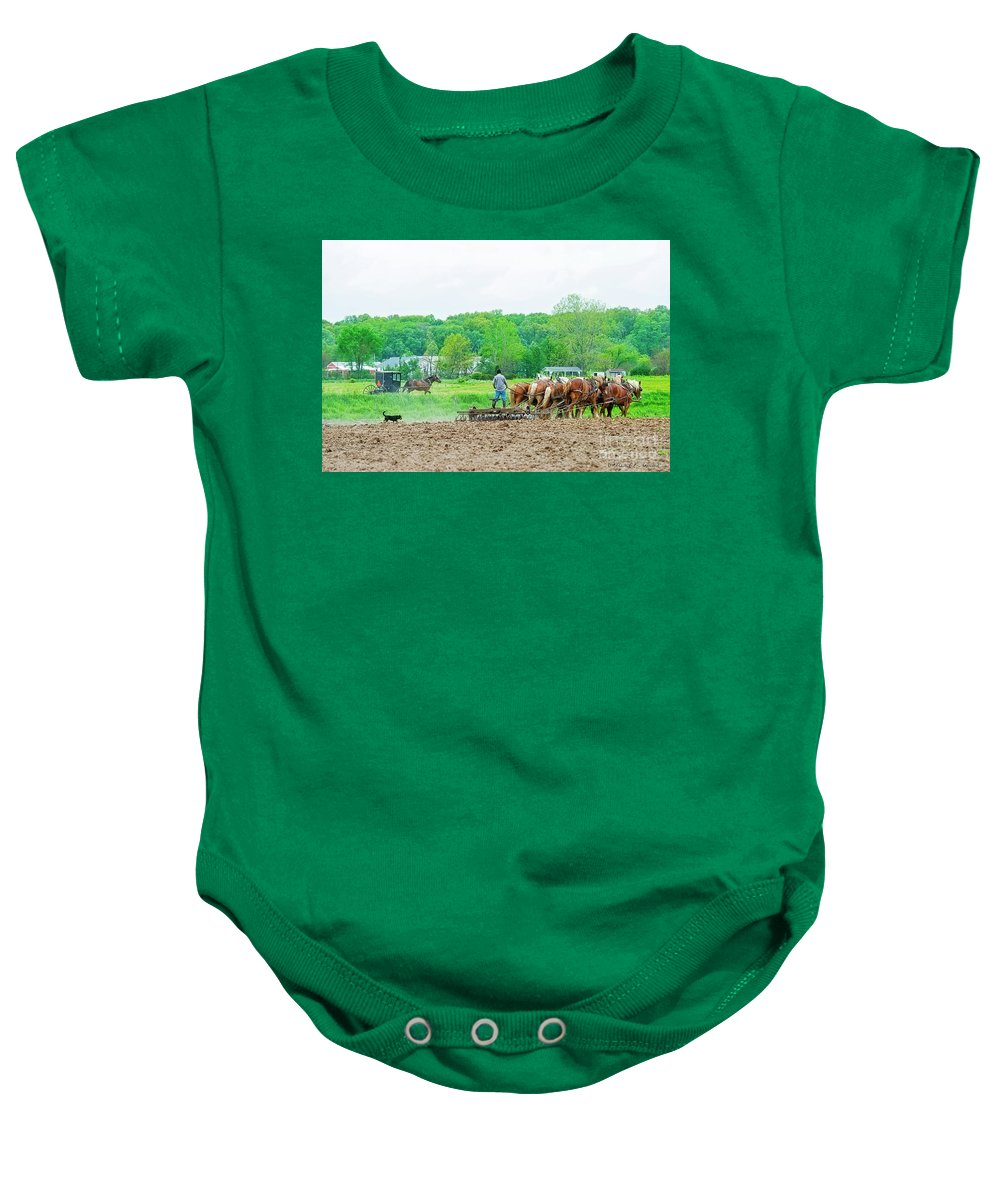 Amish Baby Onesie featuring the photograph Amish Boy Disking by David Arment