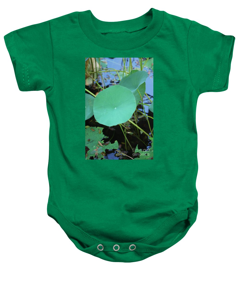 Baby Onesie featuring the photograph Crossing The Lily Pond Outback Number One by Heather Kirk