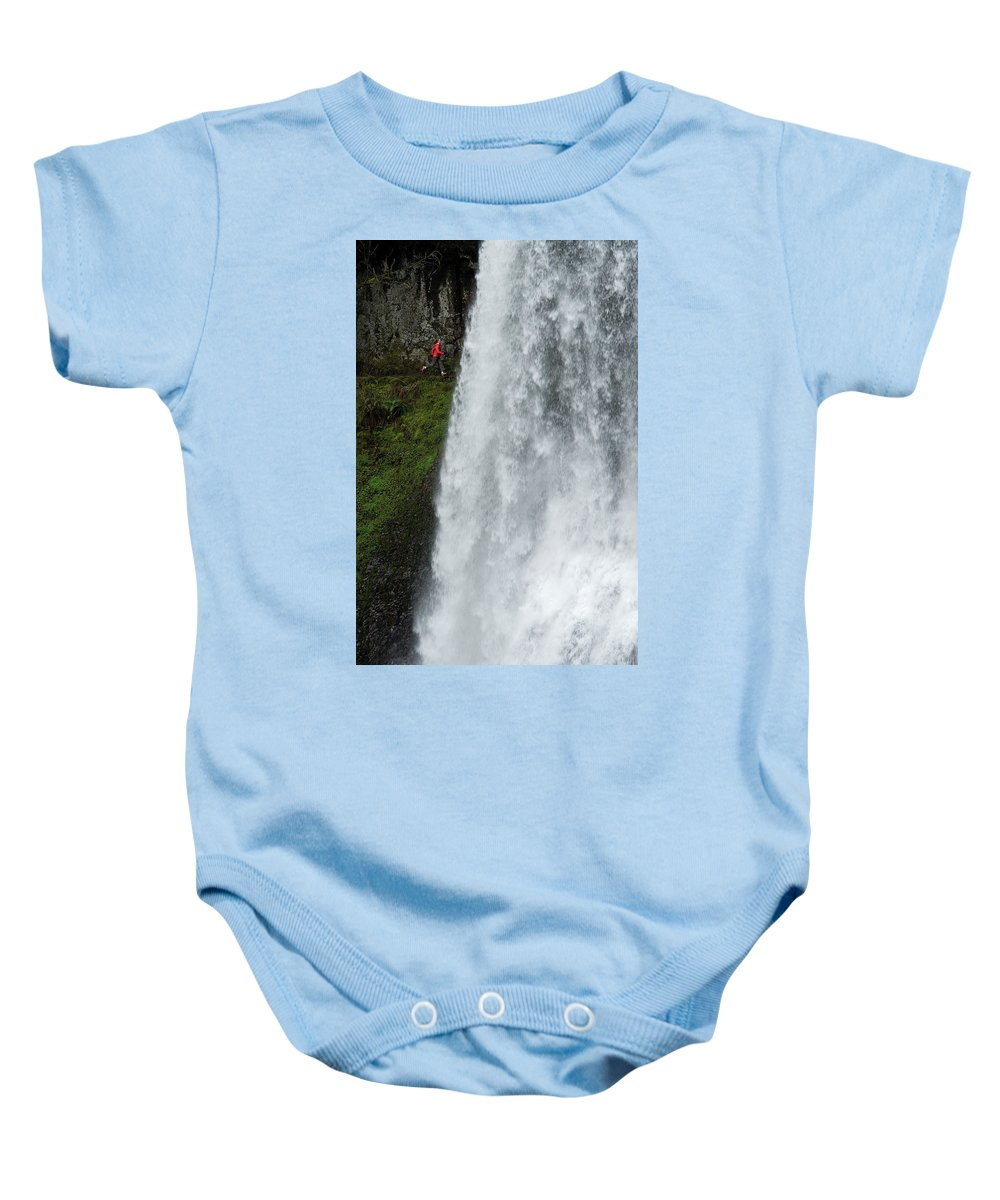 25-29 Years Baby Onesie featuring the photograph A Woman Trail Running by Rich Wheater