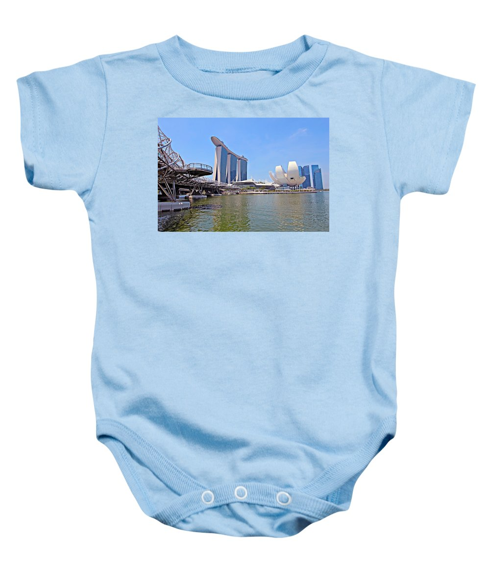 Artscience Baby Onesie featuring the photograph Singapore Artscience Museum Double Helix Bridge And Marina Bay by Paul Fell