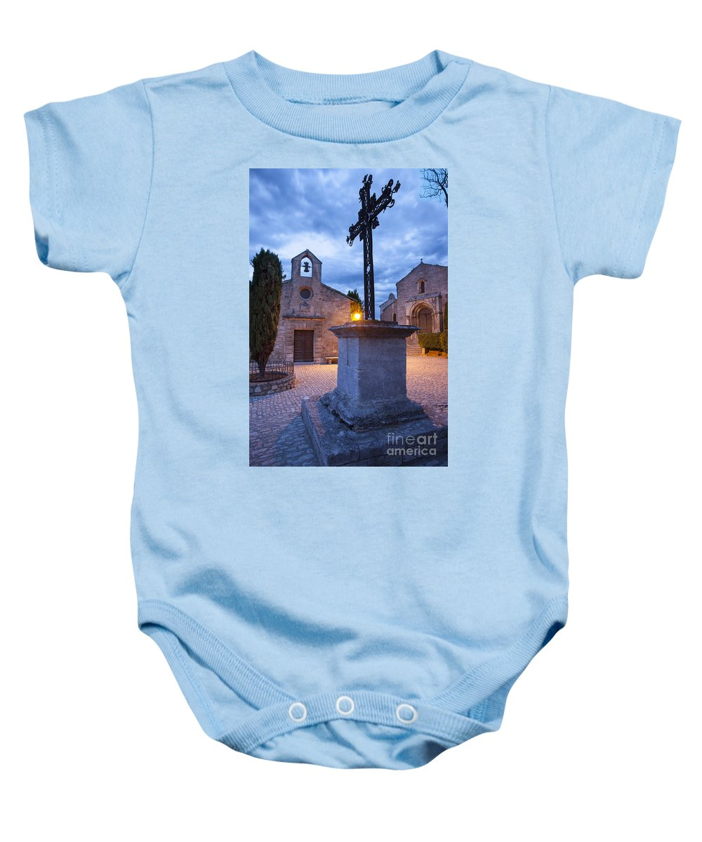 Chapel Baby Onesie featuring the photograph Les Baux Iron Cross by Brian Jannsen