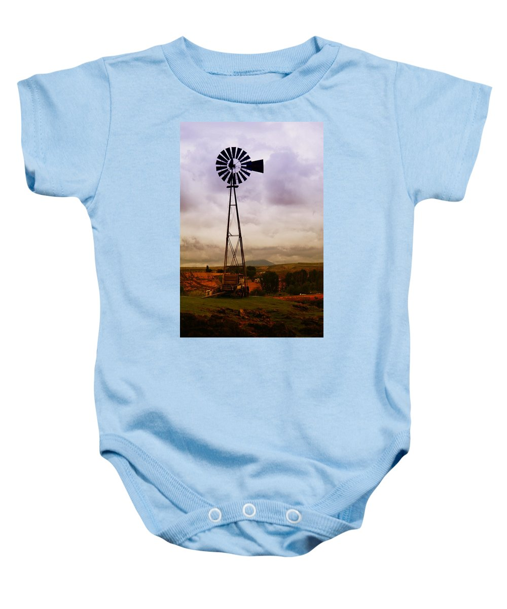 Farm Baby Onesie featuring the photograph A Windmill And Wagon by Jeff Swan