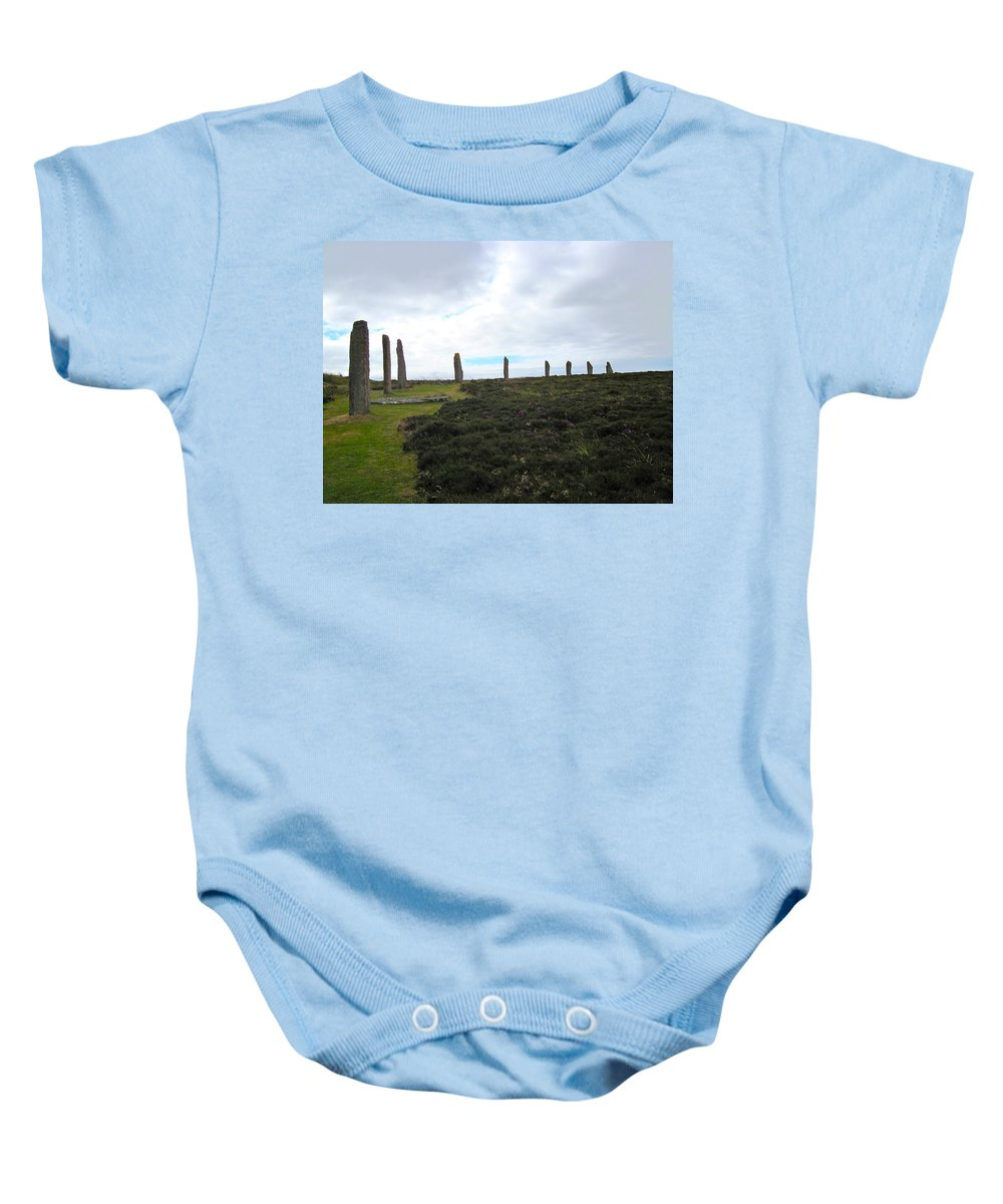 Ring Of Brodgar Baby Onesie featuring the photograph Arc Of Stones At The Ring Of Brodgar by Denise Mazzocco