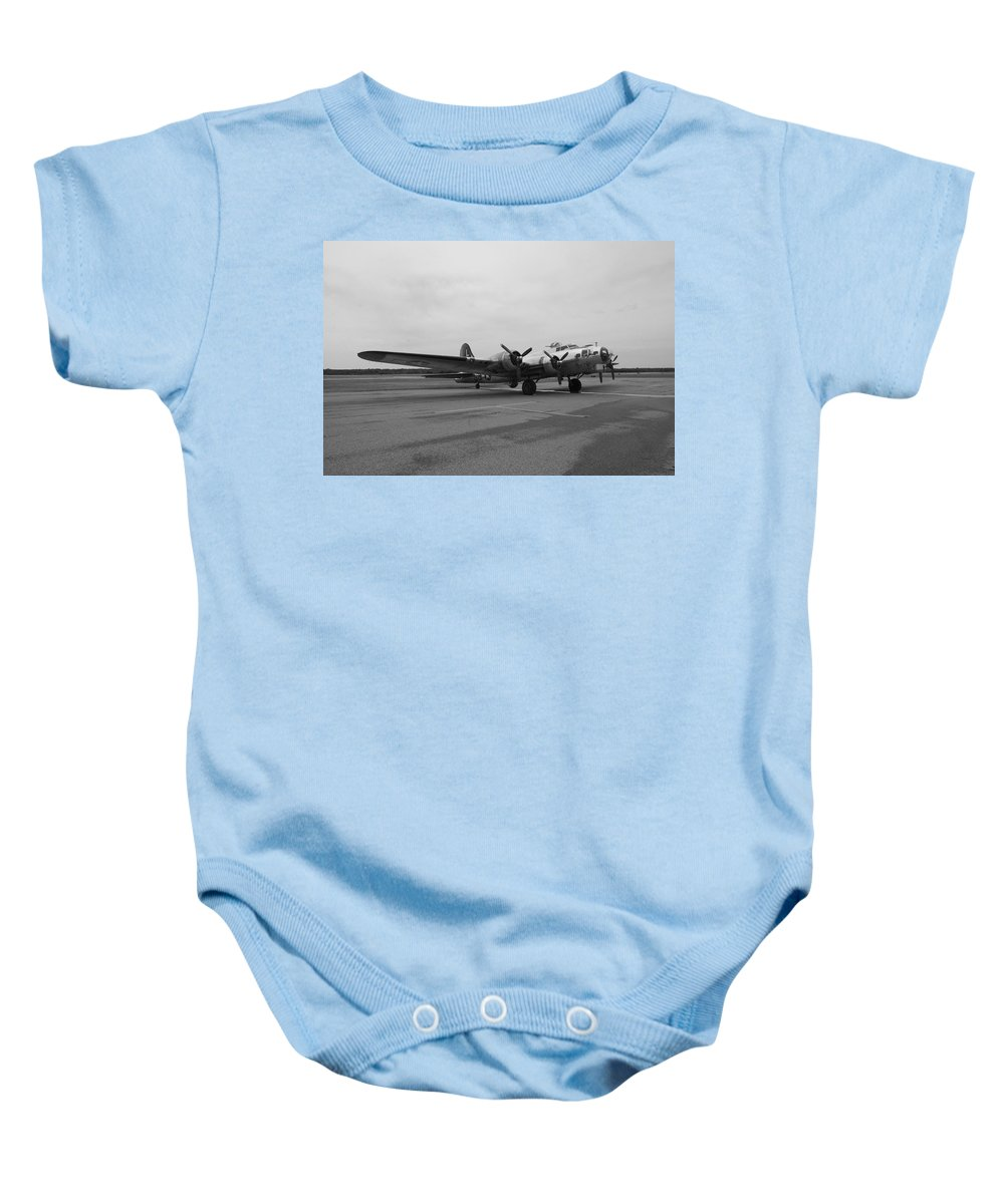 Flying Fortress Baby Onesie featuring the photograph B17 Bomber Parked by Thomas Woolworth