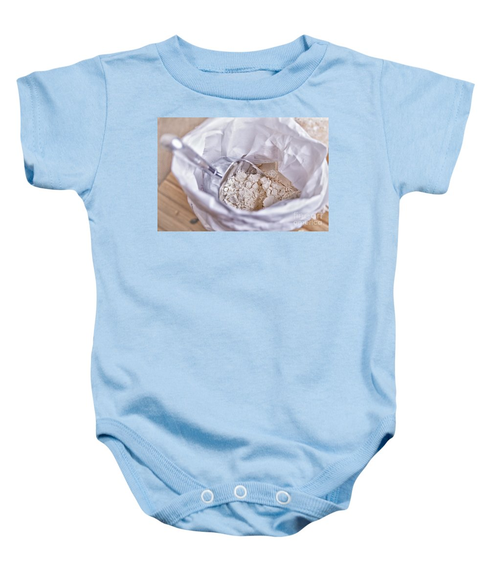 Scoop Baby Onesie featuring the photograph Bag Of Flour With Scoop by Sophie McAulay