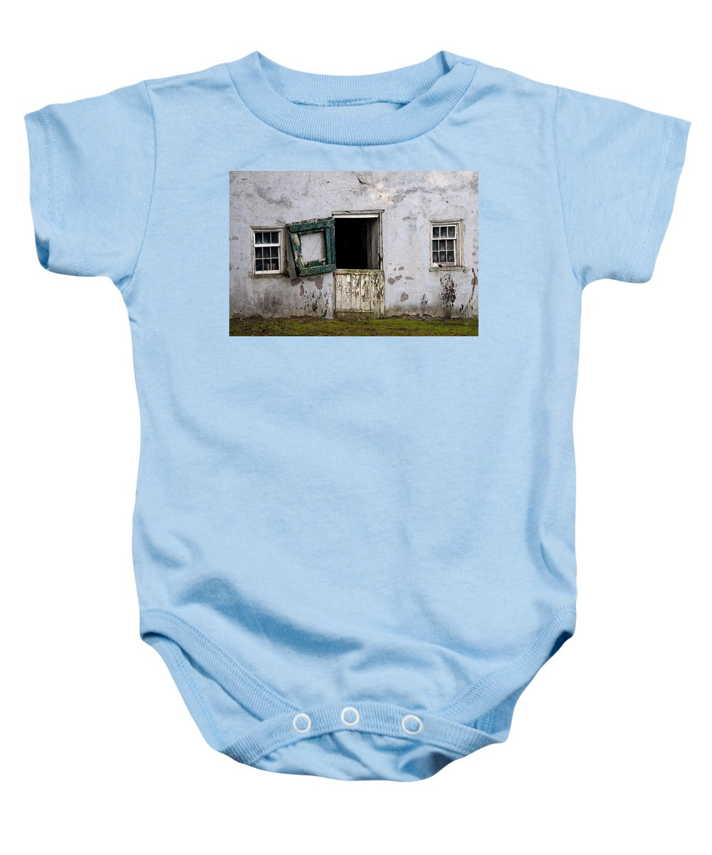 Barn Baby Onesie featuring the photograph Barn Door In Need Of Repair by Bill Cannon