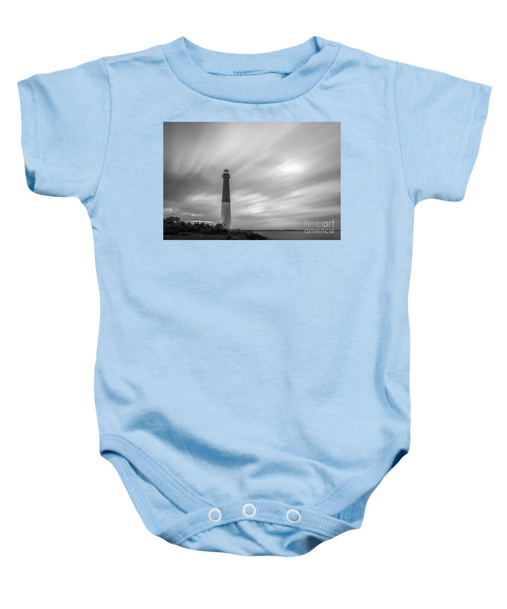 Black And White Baby Onesie featuring the photograph Barnegat Lighthouse Le Sunset Bw by Michael Ver Sprill