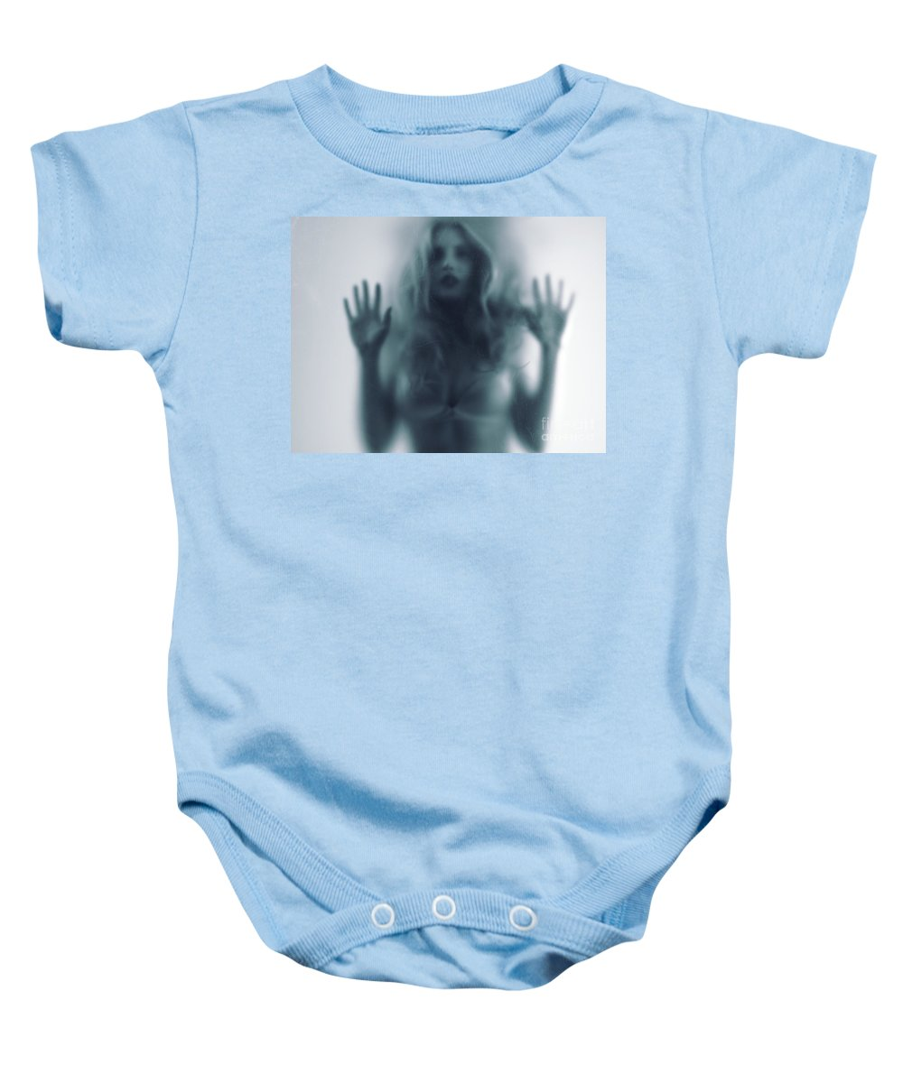 Woman Baby Onesie featuring the photograph Blurred Young Woman Silhouette Behind Glass by Oleksiy Maksymenko