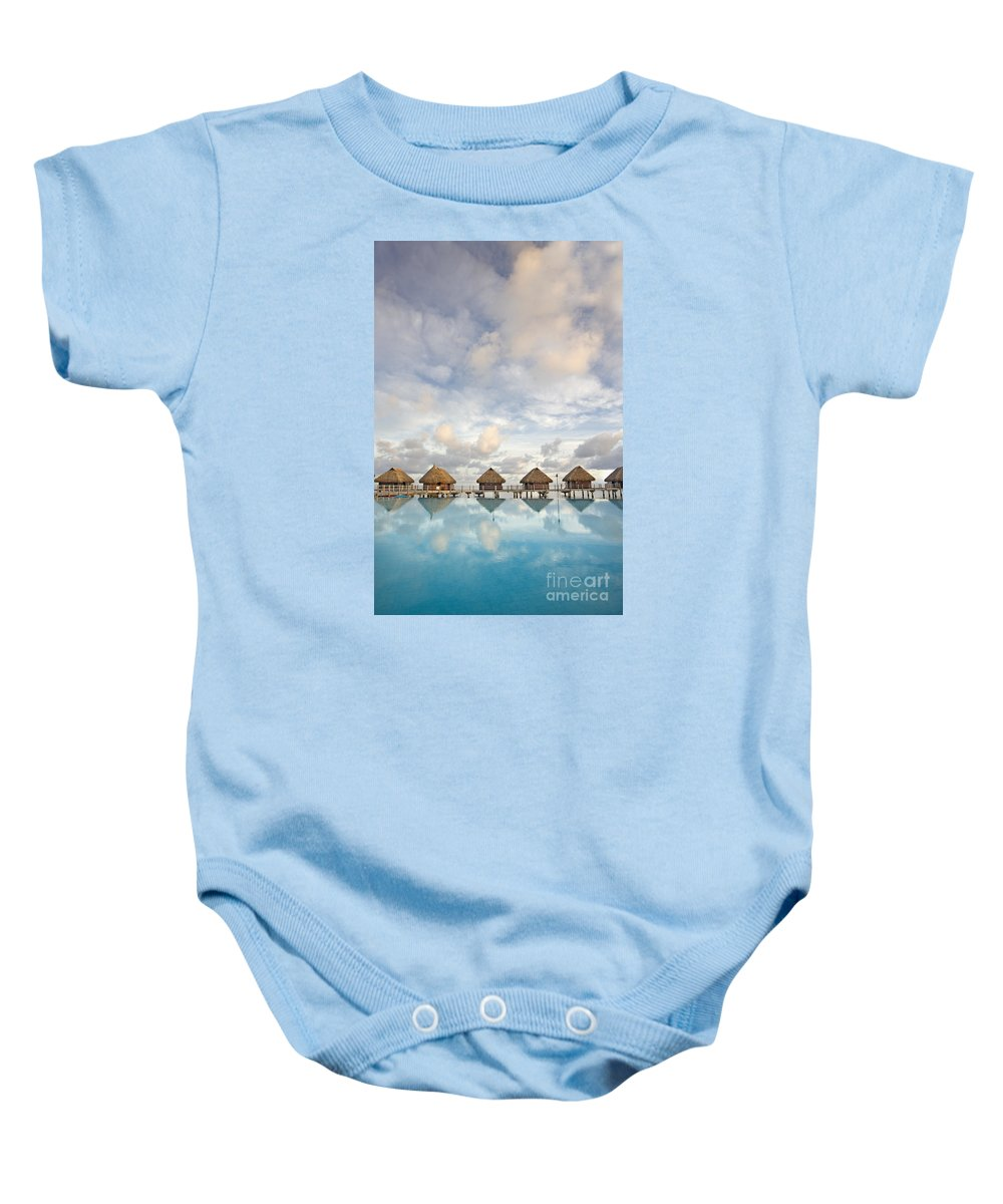 Above Baby Onesie featuring the photograph Bungalows Over Ocean II by M Swiet Productions