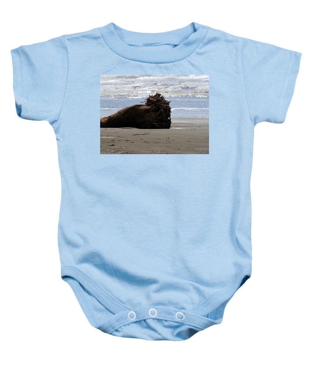 Pacific Driftwood Baby Onesie featuring the photograph Coastal Driftwood by Jeanette C Landstrom