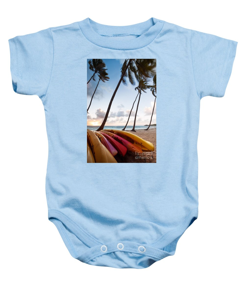 Idyllic Baby Onesie featuring the photograph Colorful Kayaks On Beach In The Caribbean by Matteo Colombo