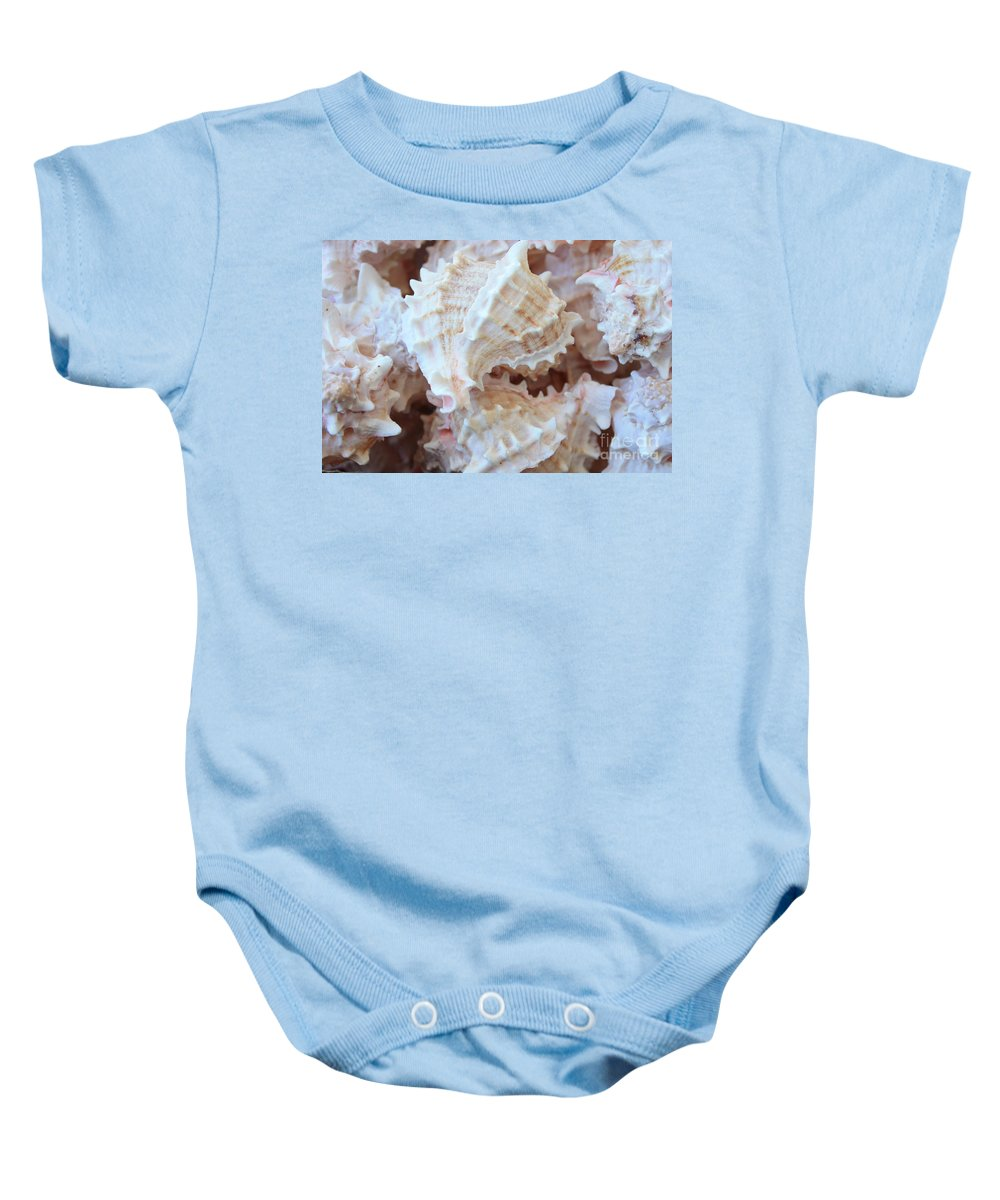 Shells Baby Onesie featuring the photograph Conches by Carol Groenen