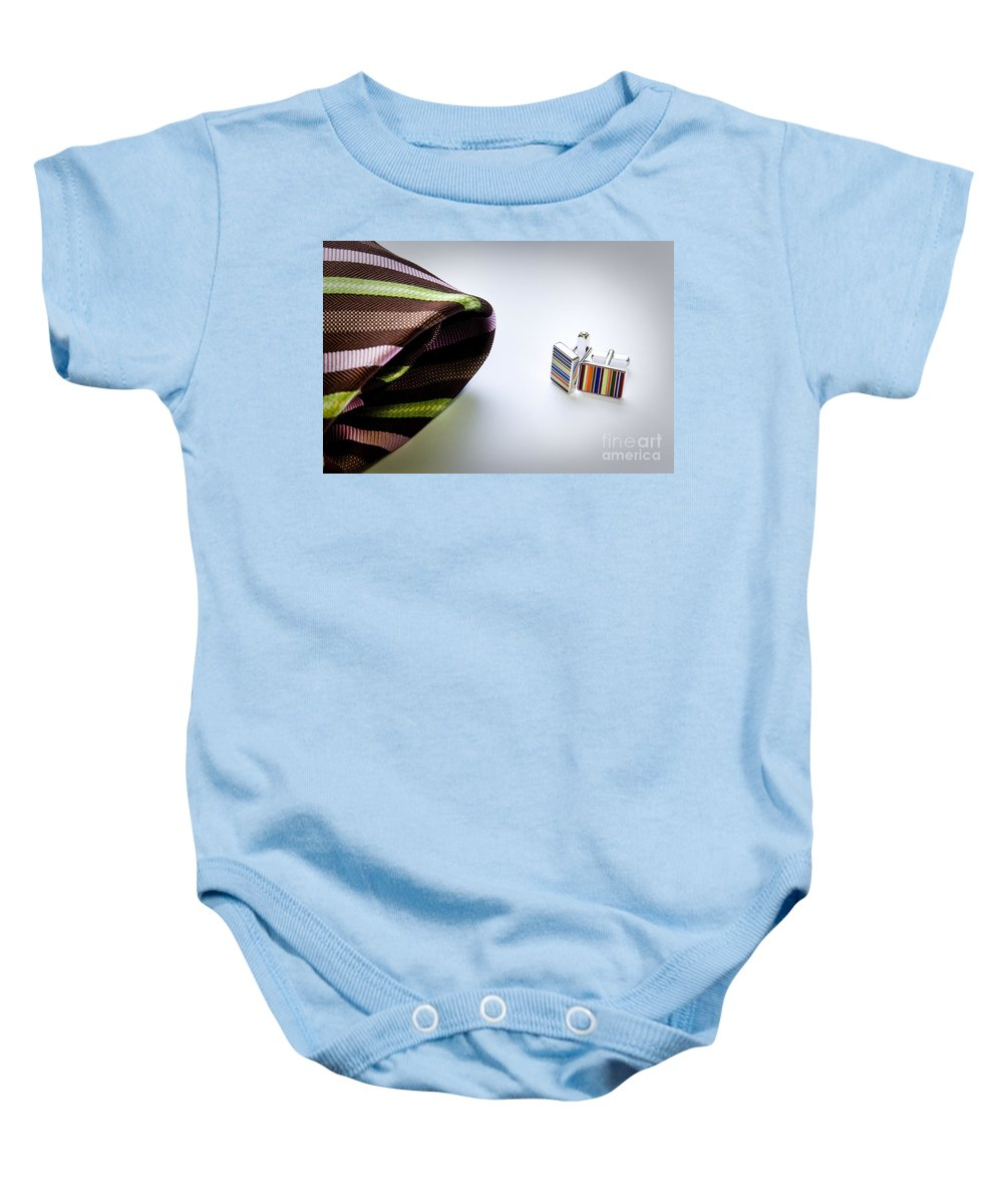 Apparel Baby Onesie featuring the photograph Cuff Links by Tim Hester