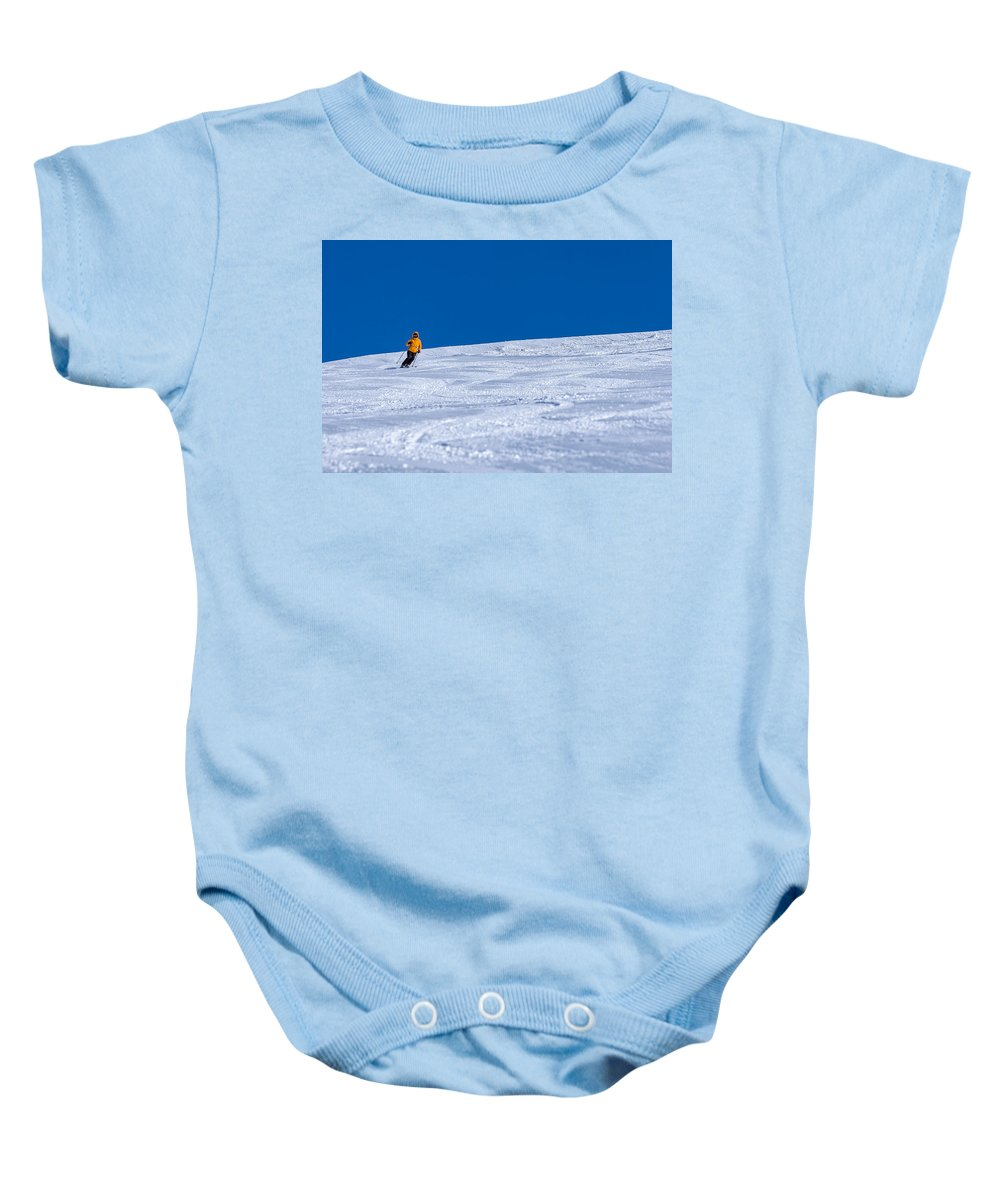 Blue Baby Onesie featuring the photograph First Run by Sebastian Musial