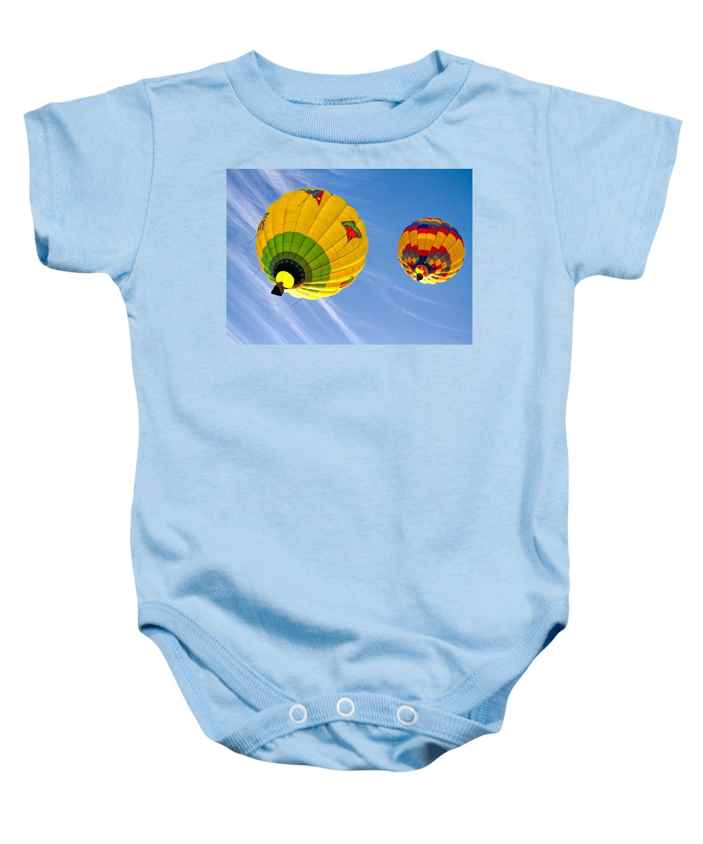 Hot Air Balloon Baby Onesie featuring the photograph Floating Upward Hot Air Balloons by Bob Orsillo