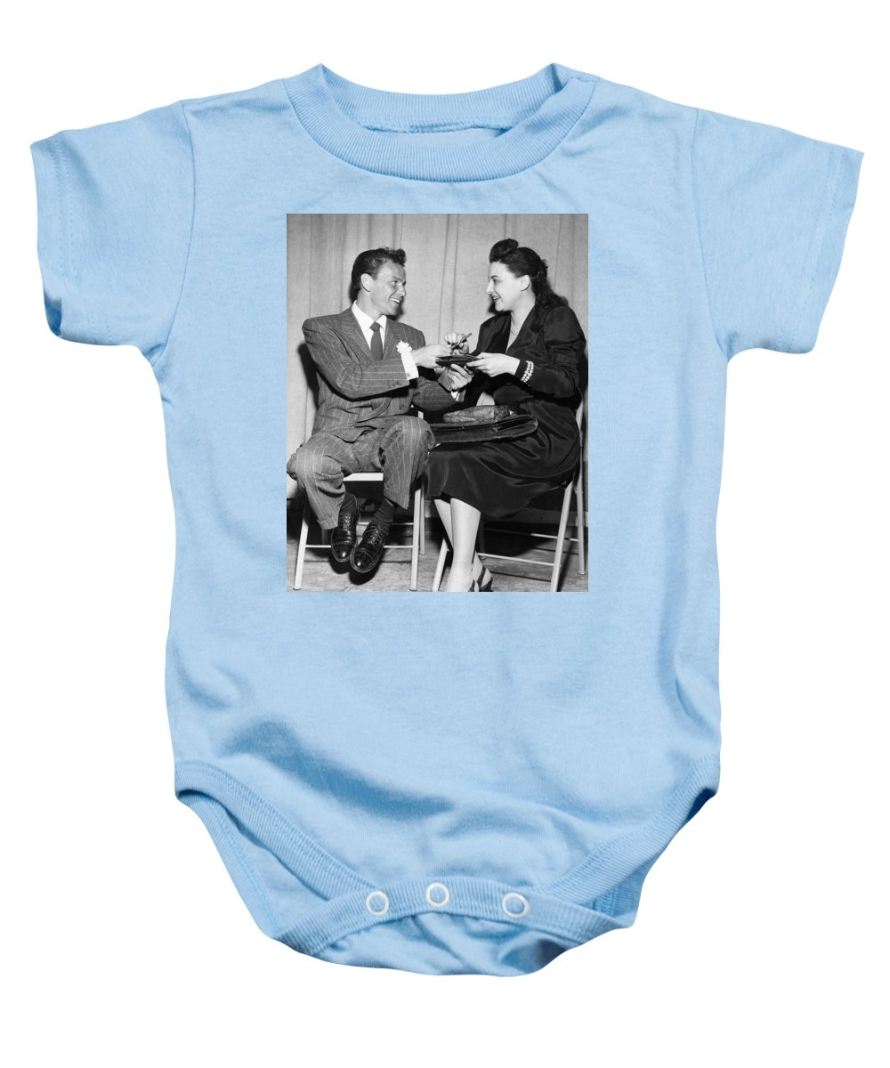 1946 Baby Onesie featuring the photograph Frank Sinatra Signs For Fan by Underwood Archives