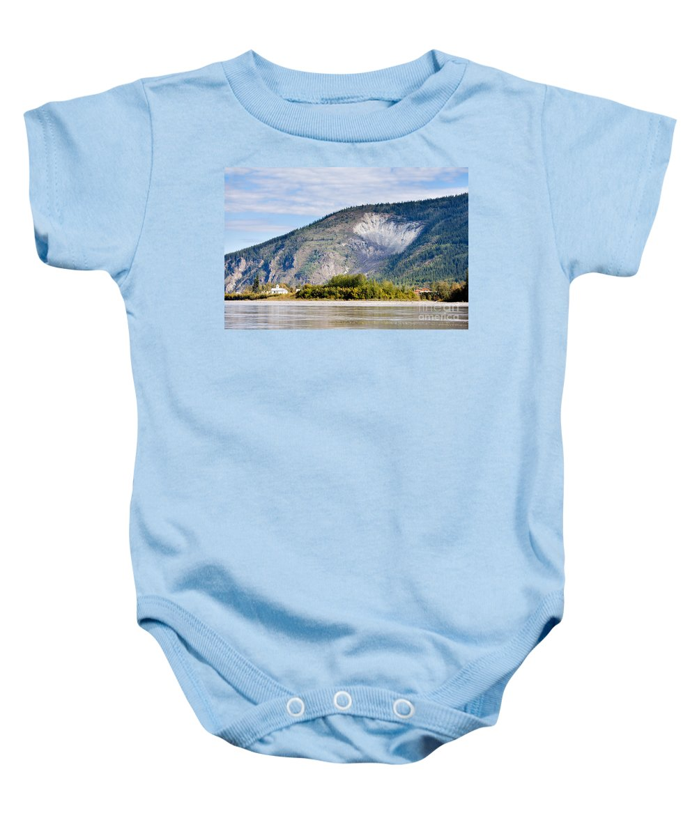 Attraction Baby Onesie featuring the photograph Goldrush Town Dawson City From Yukon River Canada by Stephan Pietzko