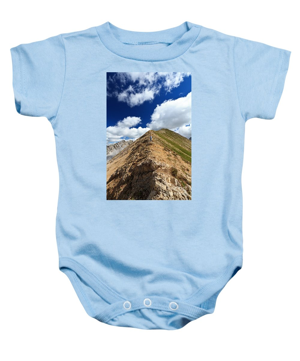 Active Baby Onesie featuring the photograph Hiker On Mountain Ridge by Antonio Scarpi