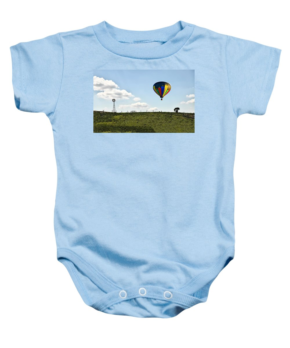 Hot Baby Onesie featuring the photograph Hot Air Balloon In The Farmlands by Bill Cannon