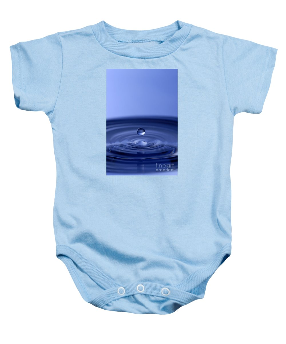 Water Drop Baby Onesie featuring the photograph Hovering Blue Water Drop by Anthony Sacco