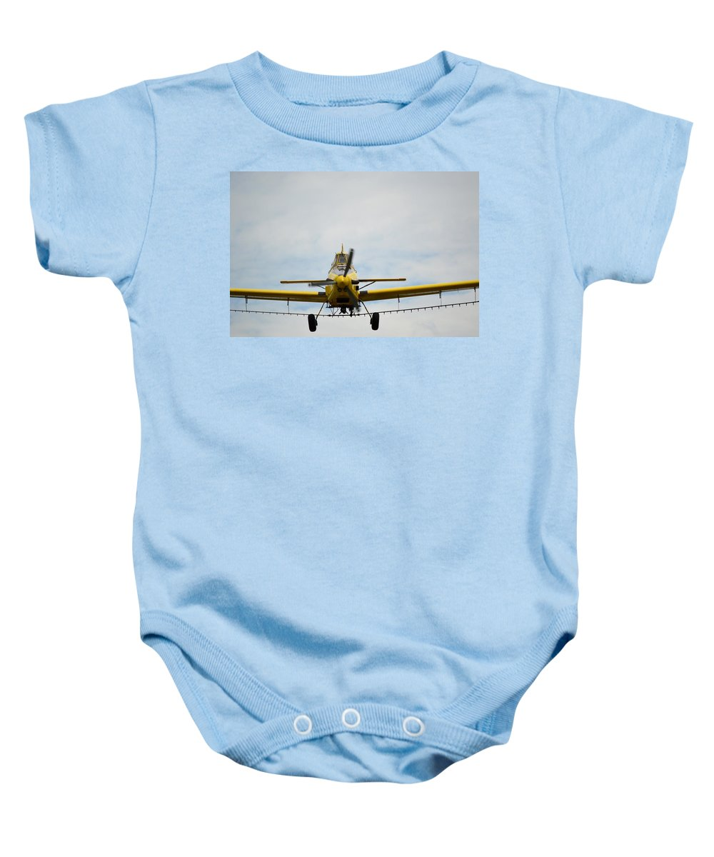Airplane Baby Onesie featuring the photograph It's Coming Right At Us by Bonfire Photography