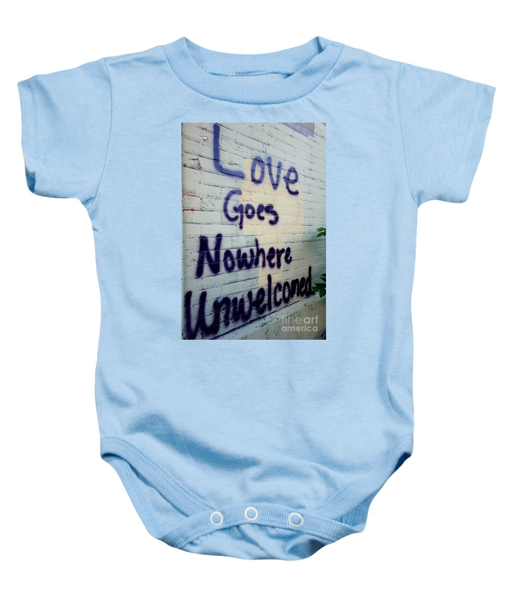 Love Yourself Baby Onesie featuring the photograph Love Goes Nowhere Unwelcomed by Jacqueline Athmann