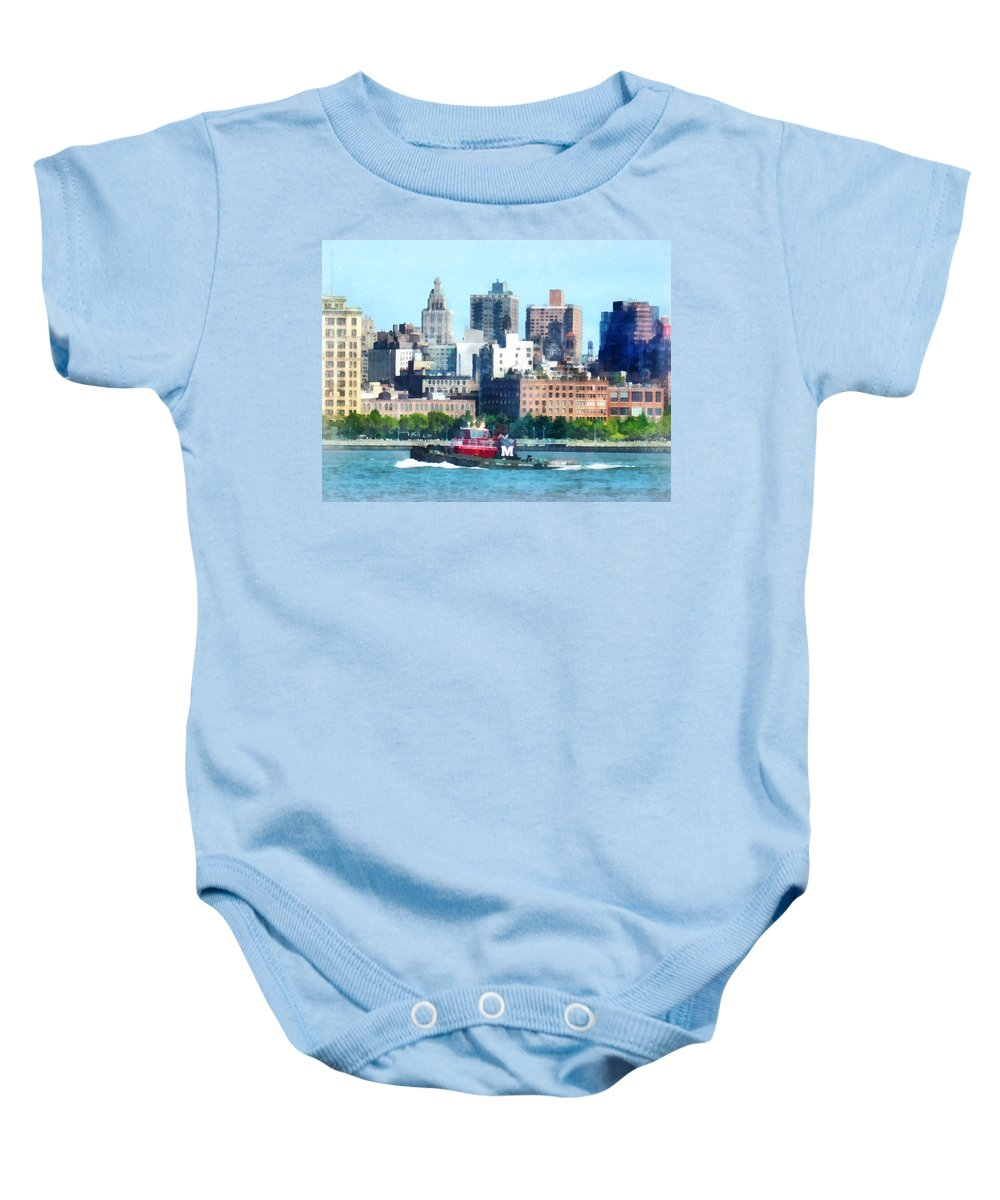 Tugboat Baby Onesie featuring the photograph Manhattan - Tugboat Against Manhattan Skyline by Susan Savad