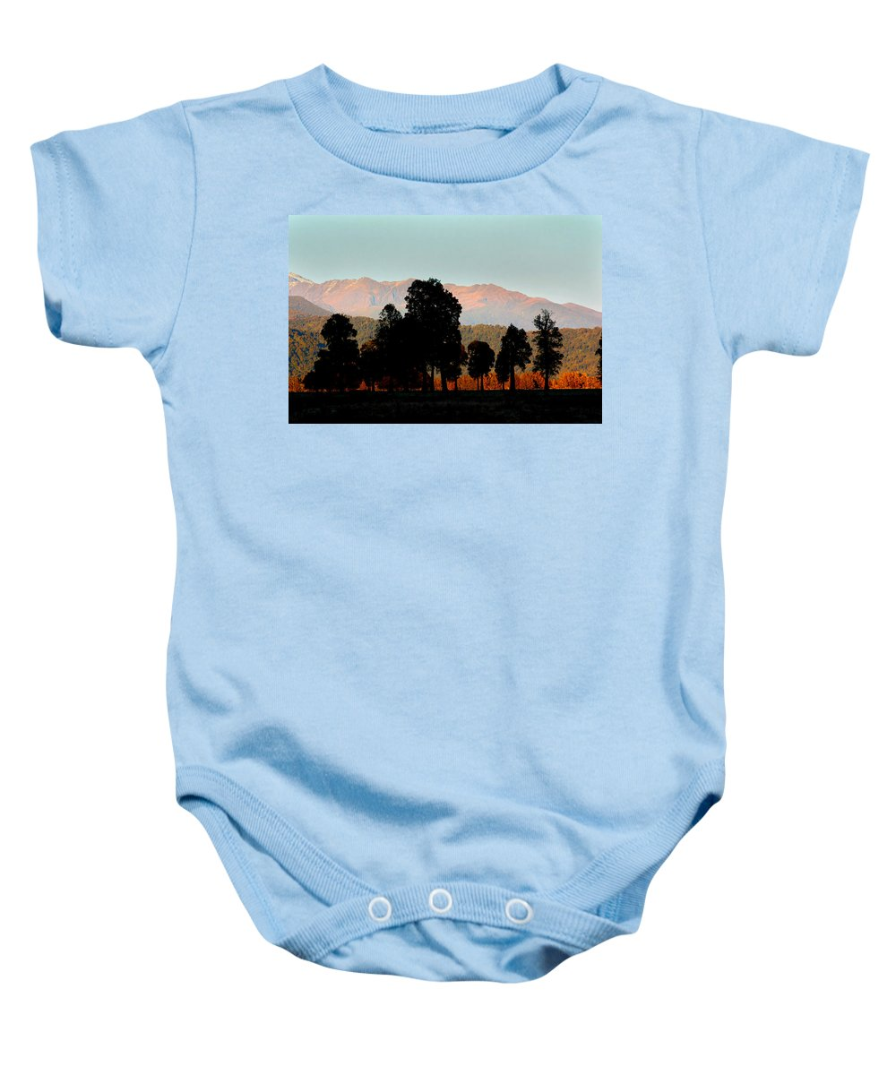 New Zealand Prints Baby Onesie featuring the photograph New Zealand Silhouette by Amanda Stadther