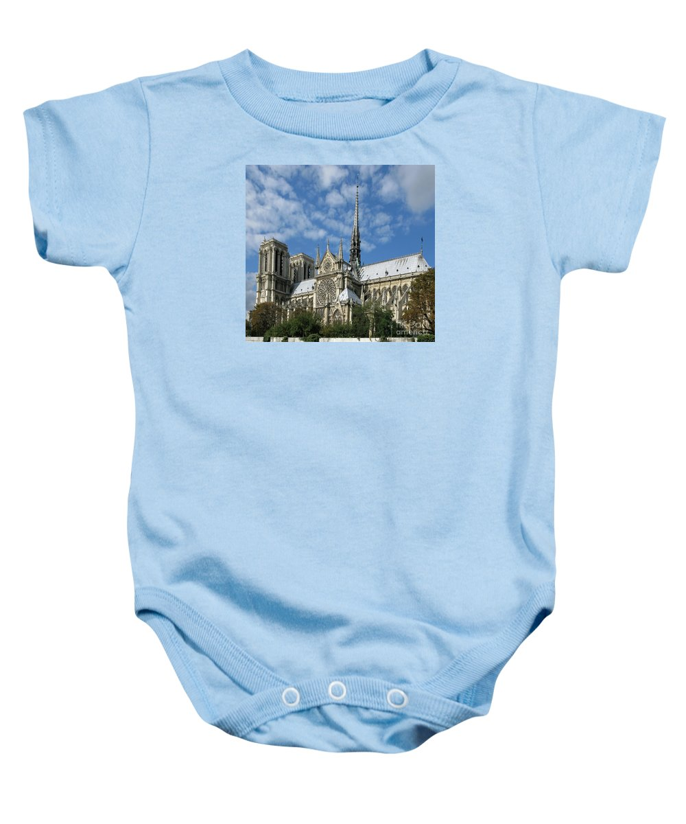 Notre Dame Baby Onesie featuring the photograph Notre Dame Cathedral by Ann Horn