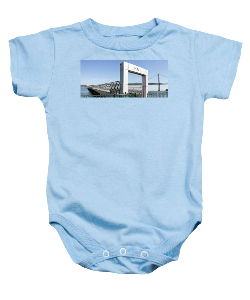San Baby Onesie featuring the photograph Oakland Bay Bridge By Pier 14 In San Francisco by Jit Lim