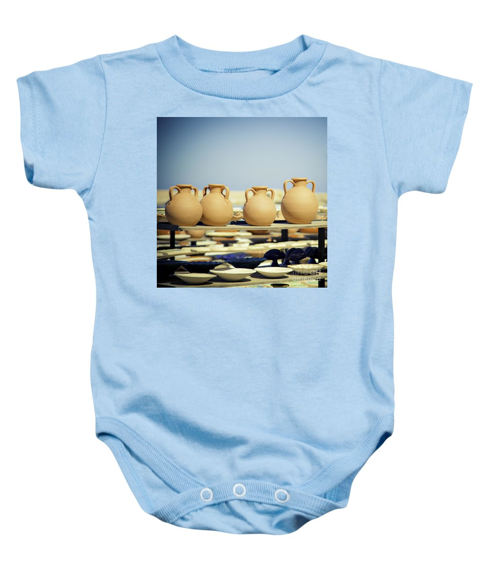 Greece Baby Onesie featuring the photograph Pottery Market by Sophie McAulay