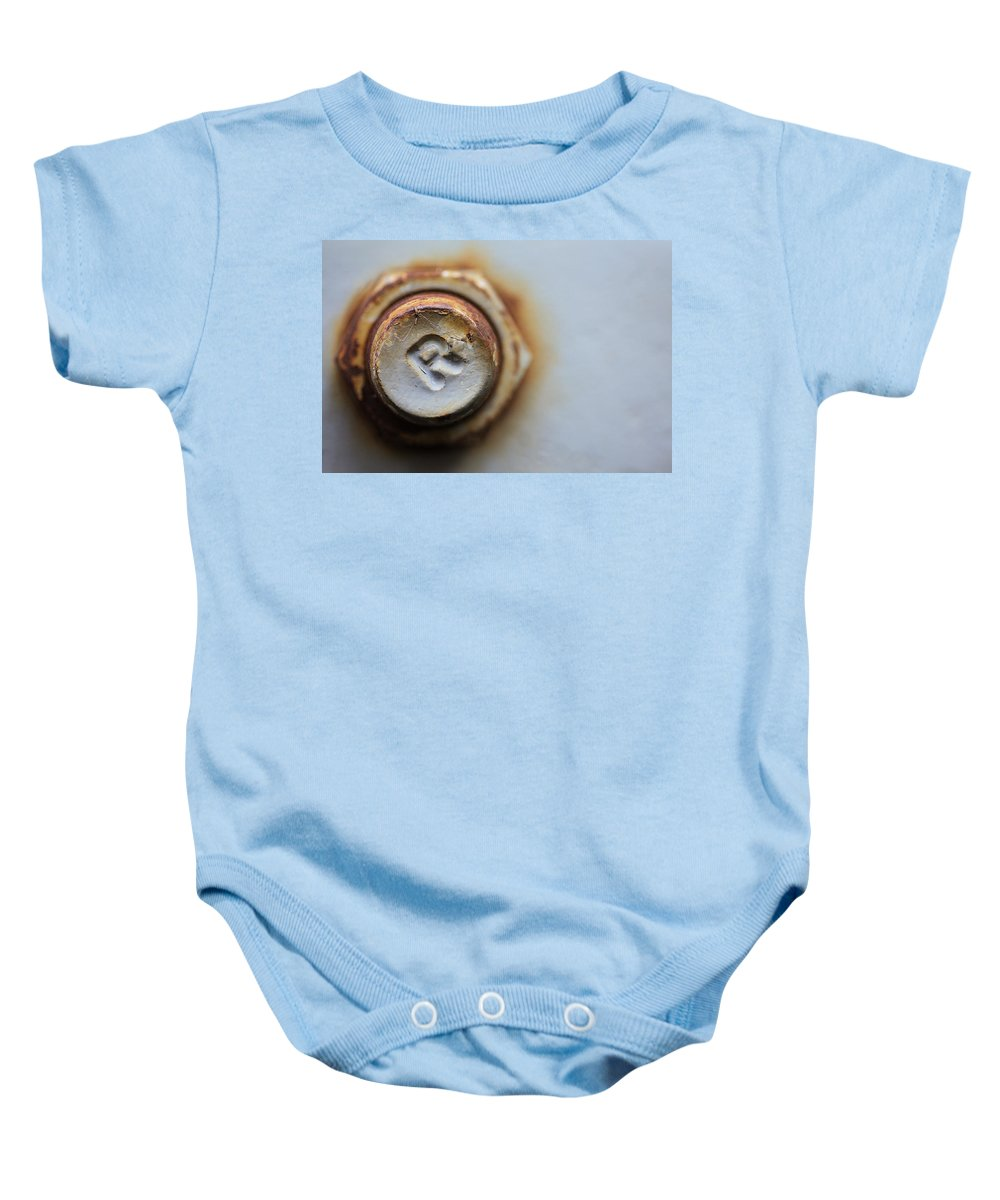 Bolt Baby Onesie featuring the photograph R Bolted by Karol Livote