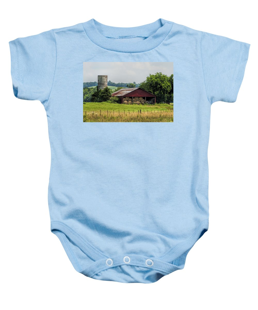 Barn Baby Onesie featuring the photograph Red Barn And Bales Of Hay by Kathy Clark