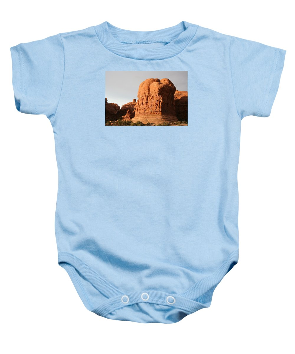 Rocks Baby Onesie featuring the photograph Rockformation Arches Park by Christiane Schulze Art And Photography
