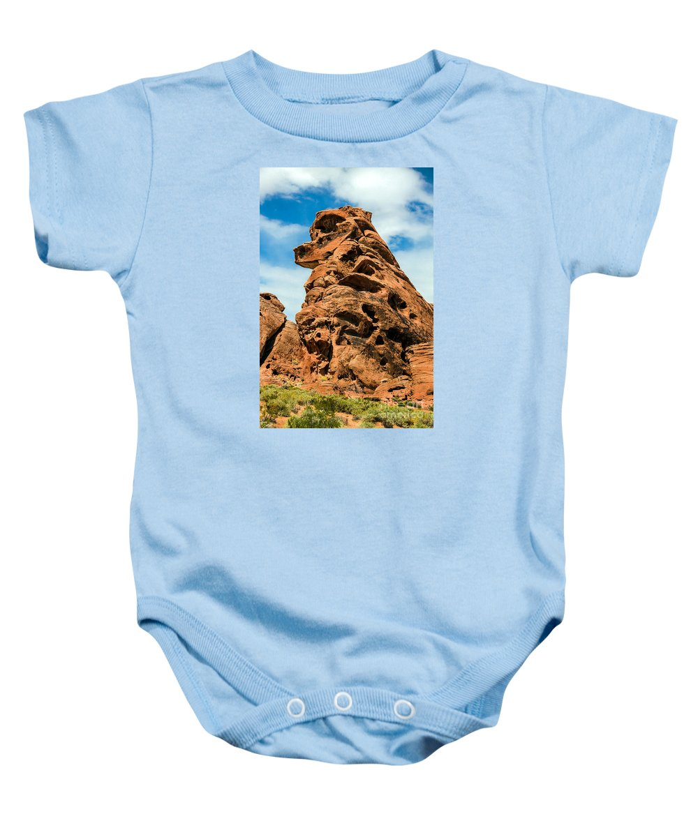 Valley Of Fire Baby Onesie featuring the photograph Sandstone Husky by Robert Bales
