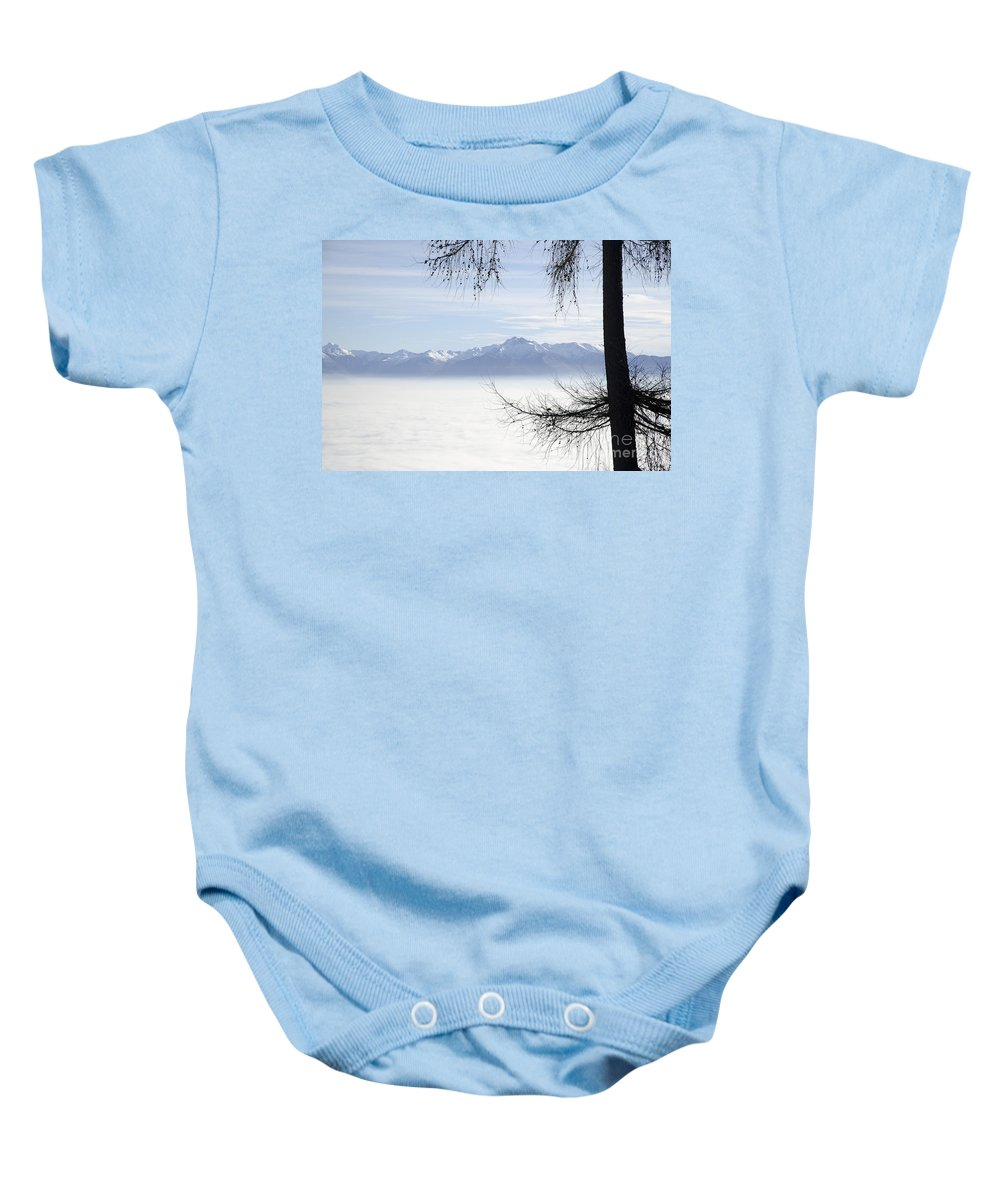 Sea Of Fog Baby Onesie featuring the photograph Sea Of Fog And A Tree by Mats Silvan