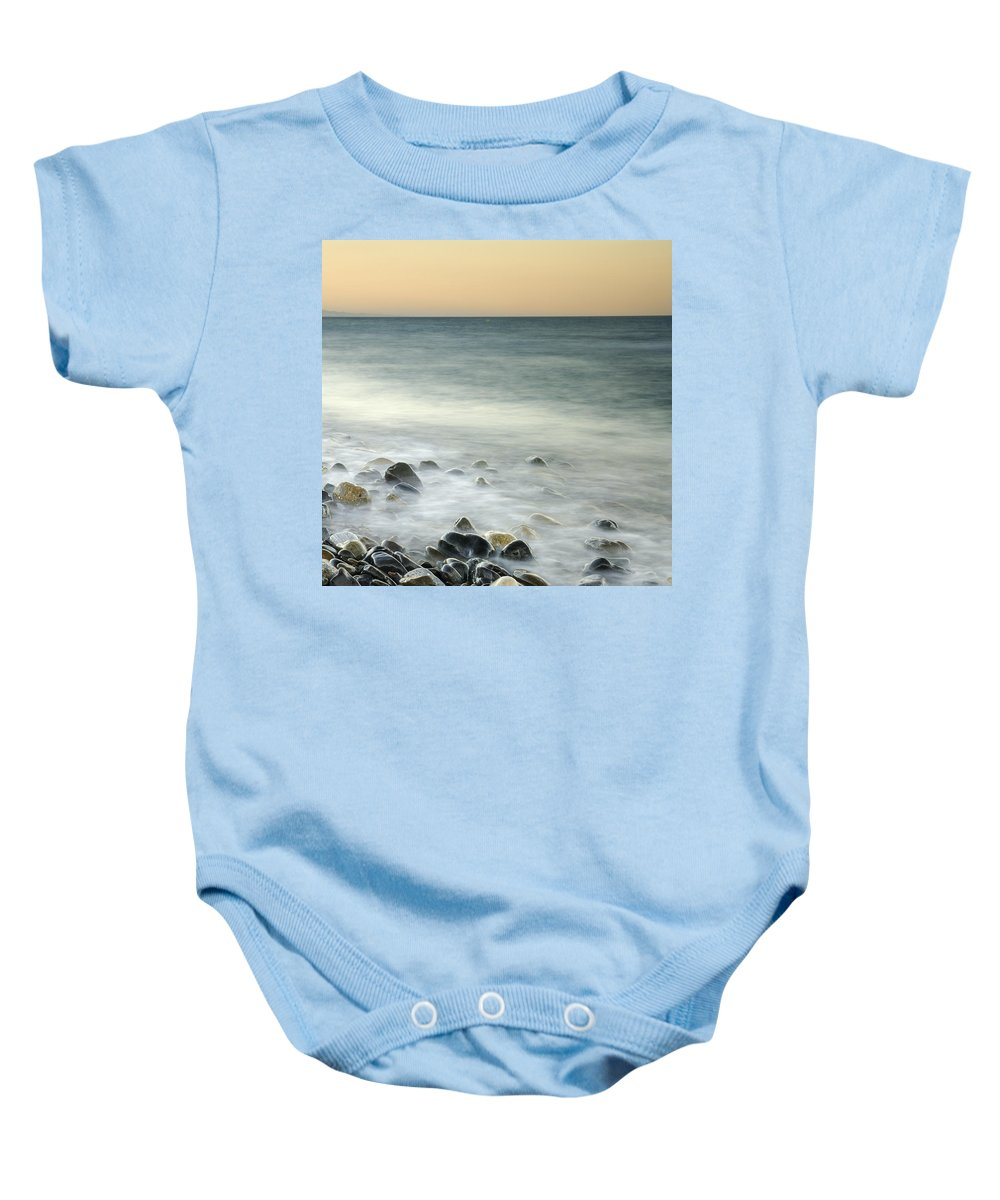 Seascape Baby Onesie featuring the photograph Shiny Rocks At The Sea by Guido Montanes Castillo