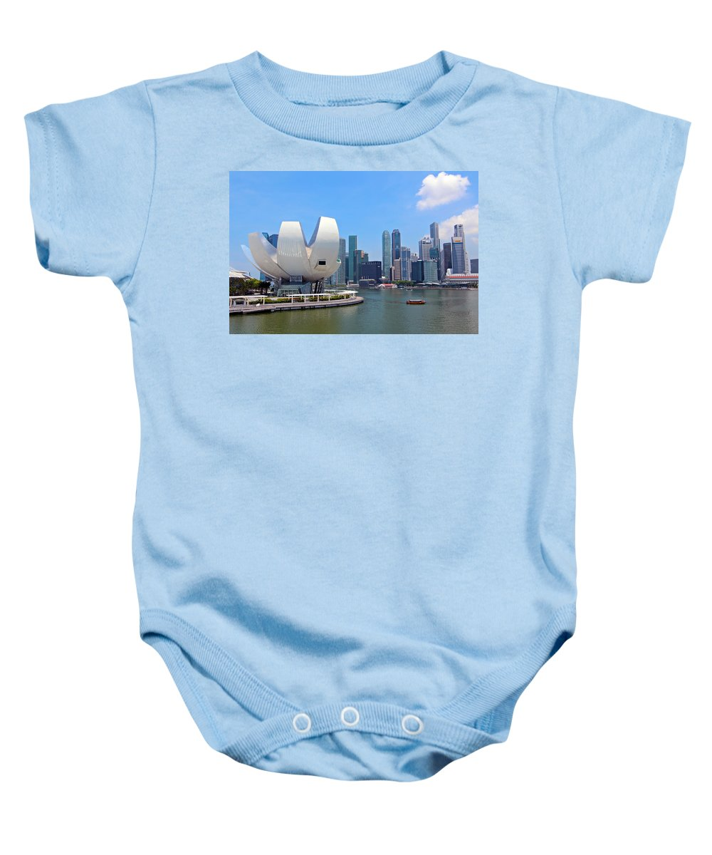Singapore Baby Onesie featuring the photograph Singapore Artscience Museum And City Skyline by Paul Fell