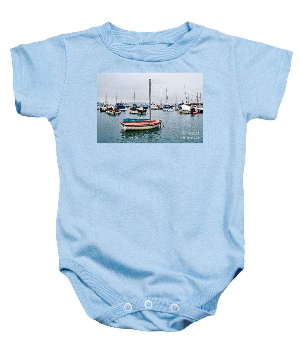 Lyme Regis Baby Onesie featuring the photograph Small Boats At Lyme Regis Harbour by Susie Peek