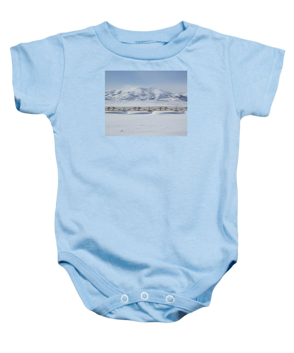 Scenic Baby Onesie featuring the photograph Snow Fence Sculpted Snow by Mike and Sharon Mathews