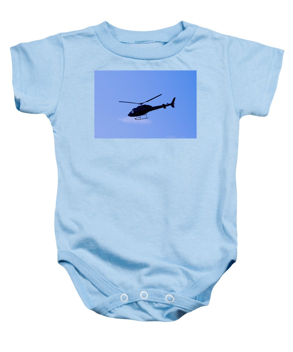 Helicopter Baby Onesie featuring the photograph Solo by Pablo Rosales