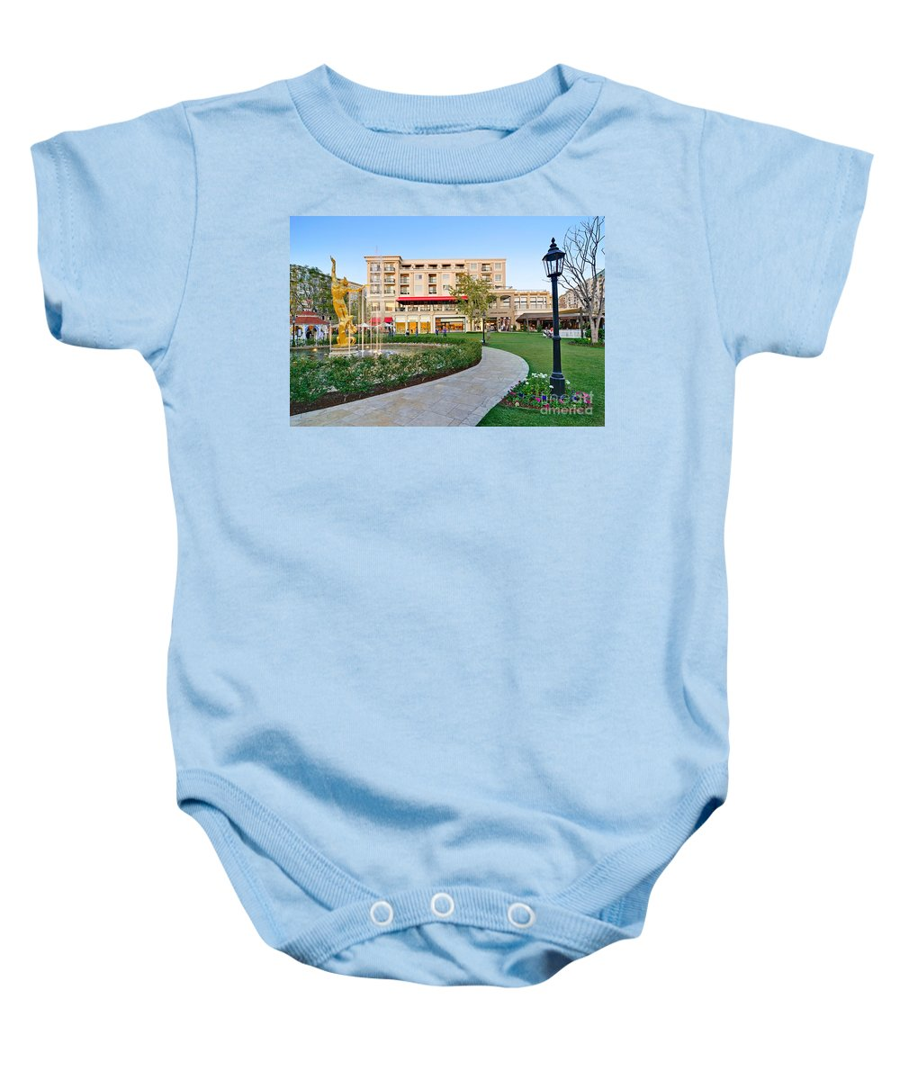 Americana Baby Onesie featuring the photograph The Americana At Brand Outdoor Shopping Mall In California. by Jamie Pham