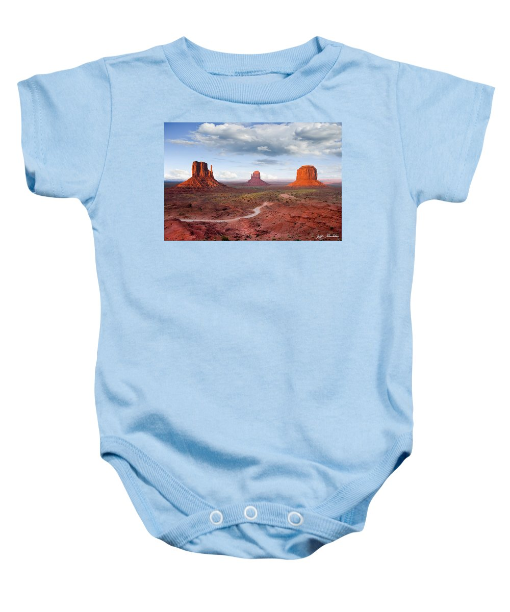 Arizona Baby Onesie featuring the photograph The Mittens And Merrick Butte At Sunset by Jeff Goulden