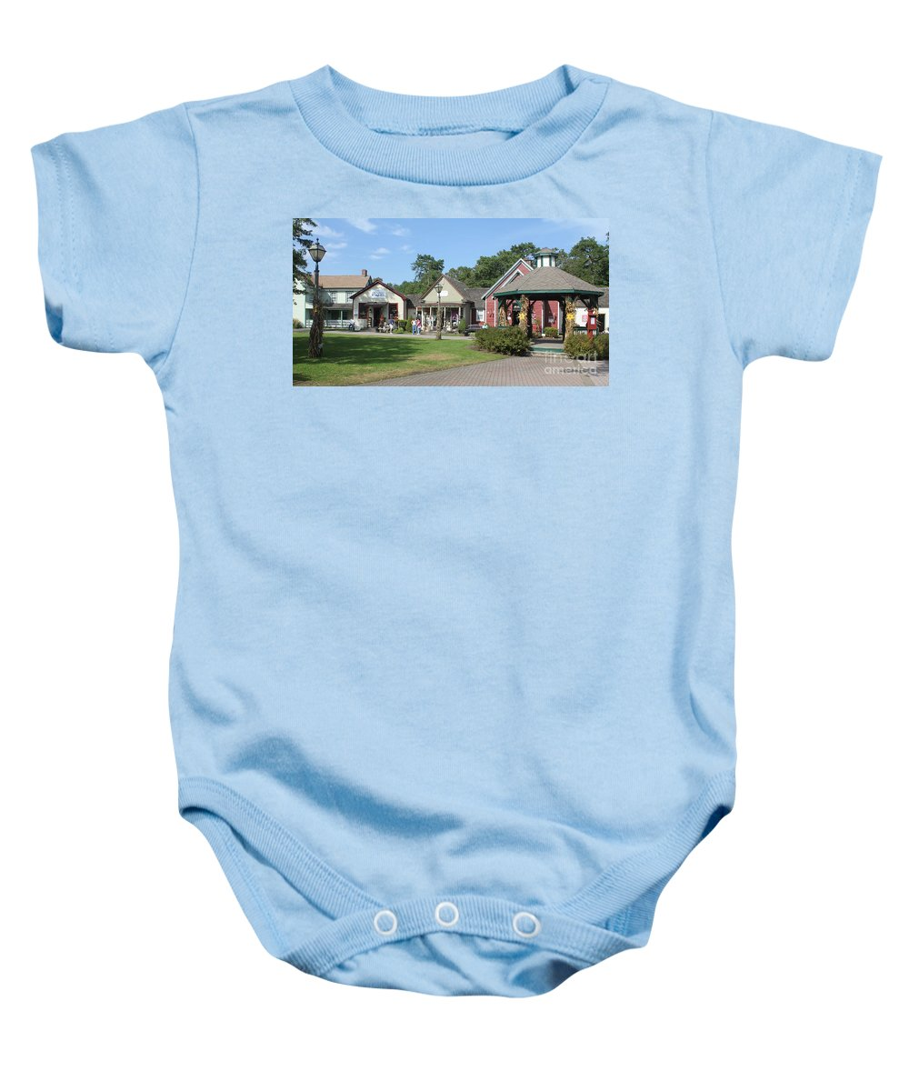 Historic Baby Onesie featuring the photograph The Shoppes by Christy Gendalia